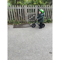 The children have a go at using the balance bikes/scooters they all enjoyed this