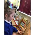Samira explored the abacus and practised her subitising knowing she could see 2 beads