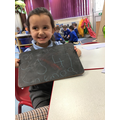 Nia enjoys writing her numbers and sounding out the letters sounds