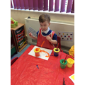 Mason chose to mix and explore colours when painting.