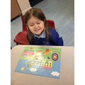 Rebecca worked hard to complete the Peppa Pig puzzle
