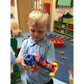 Danny used the mobile to make a super model of a car