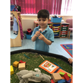The children enjoy doing role play around the story The Three Little Pigs