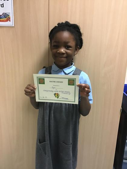 Maths award for doing really well on her maths challenge.