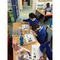 Cutting and putting pictures from the story in order.