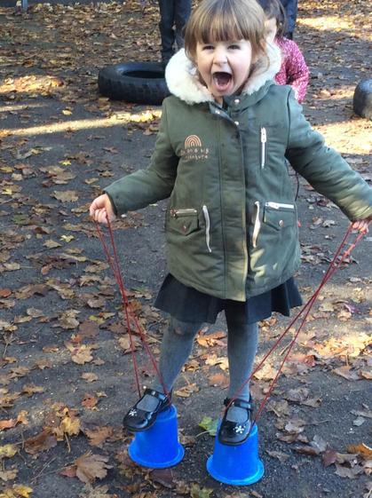 Evie beamed with pride as she accomplished her challenge of walking on stilts.