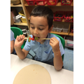 Enjoying our fruit kebabs ahead of writing instructions.