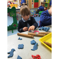 Ava Lilly makes shapes using the playdough