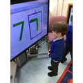 Ronnie-Jay wrote a number 7 on the IWB