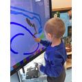 Boris explored making marks on the IWB