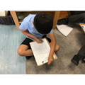 Arian working on his Geography learning challenge to compare 2 countries.