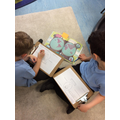 Isaac and Selim researching explorers.