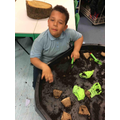We practiced planting seeds.
