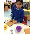 Yusuf enjoys using his number skills to count his shapes