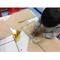 Creating cave art like the Highway rat saw in the cave.