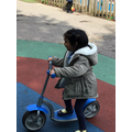 Hafsa was showing good balance weaving in and out of the cones on the scooter