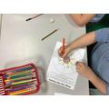 Lexi-Mai designing her own Mandala.