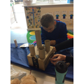 Joshua wanted more than one tower on his castle