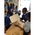 Making theatre boxes for puppet show.