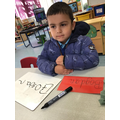 Bogdan shows off his writing skills by writing his name