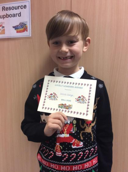 Lovely learning award for always completing his work.