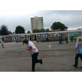 Practising throwing and catching skills for Rounders