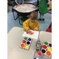 The children explore different ways to make marks with the paint