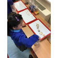 Khadija made a pattern using the shells