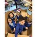 Noah, Connie, Nia, Milana and D.J. loved Being Jack-in-the-box in the cardboard box.