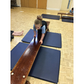 Darcey explores different ways to move using the bench