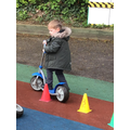 Sonny showed good balance weaving in and out of the cones on the scooter