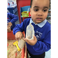 The children distinguished the difference between empty and full when playing in the sand