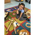 Nia made a unicorn cow using the loose parts.