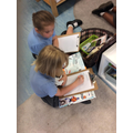 Willow and Daisie researching about Antarctica in preparation for their writing.