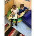 Braidon and Sonny enjoyed reading books in the book corner.