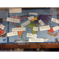 Oyin's learning of locating continents and oceans.