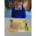 Joshua chose to make somewhere for his favourite animal , a Llama to live.