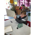 Sonny is able to form recognisable letters when writing his name