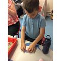 Joshua creating tissue paper snail