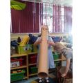Milana enjoys making sounds through the tube