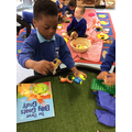 Rayyan used the props to recalll the story The Three Billy Goats Gruff