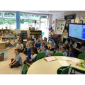Lion Class listening to a piece of music during their Music session.
