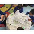 Looking at maps.