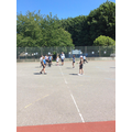 Practising throwing and catching in Rounders