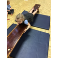 Milana explores moving in different ways across the bench