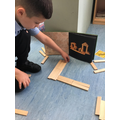 Selim problem solving and instruction following with Kapla