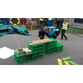Buiding a house with crates and wooden blocks
