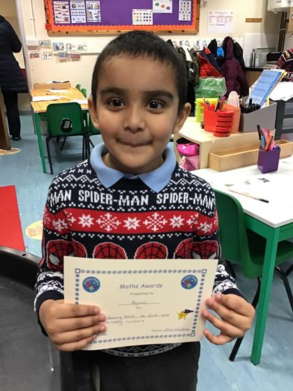 Arjun for working hard to fill in the missing numbers on the Christmas stockings.