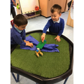 The children enjoy acting out parts of the story The Three Billy Goats Gruff