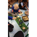 We then used what we learnt to use our small world resources to make a countryside.